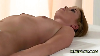 Blonde in white oils and fucks brunette
